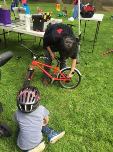 Club Sprouts member getting a free bike tune-up at the market.